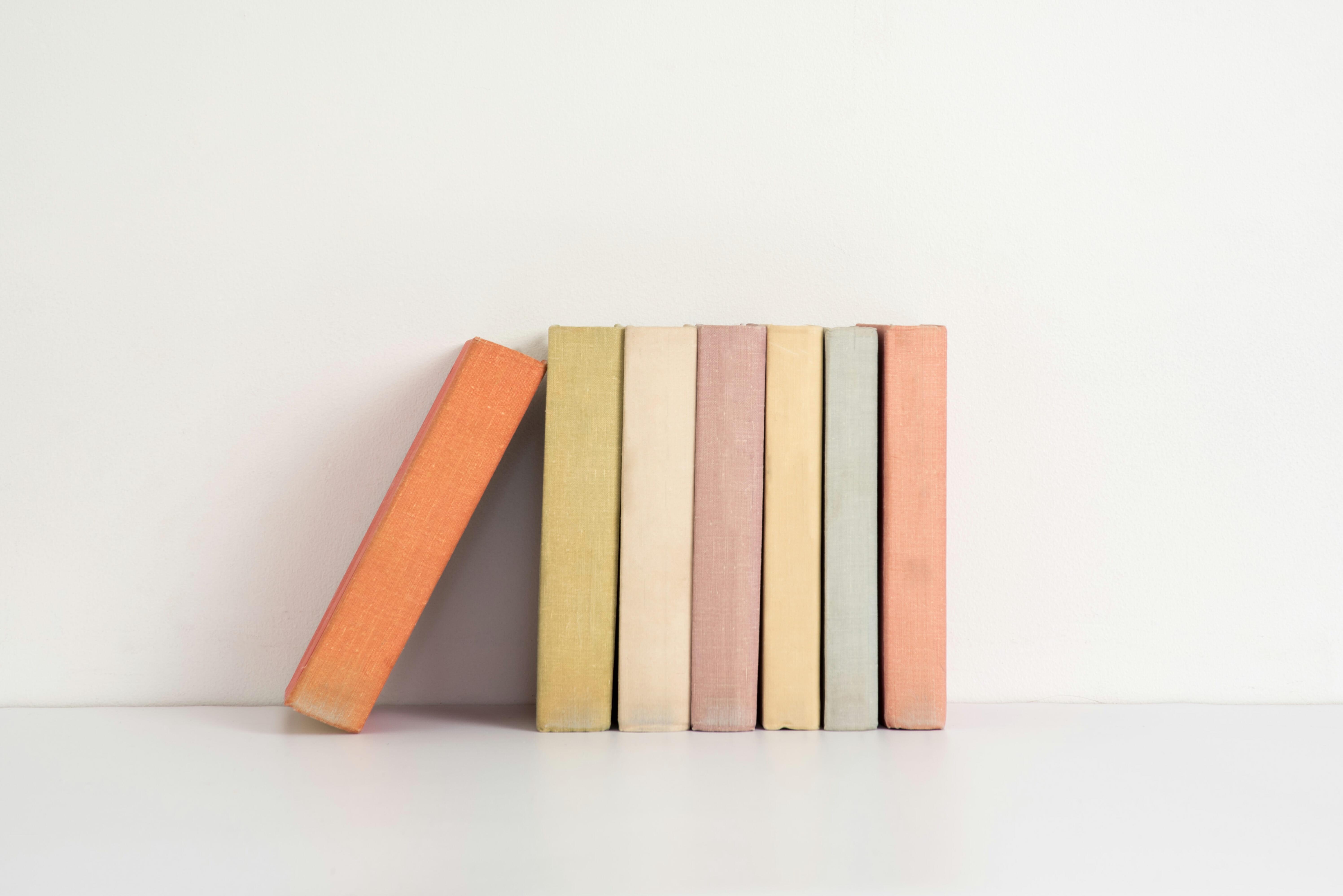 Colorful hardback books on the shelf